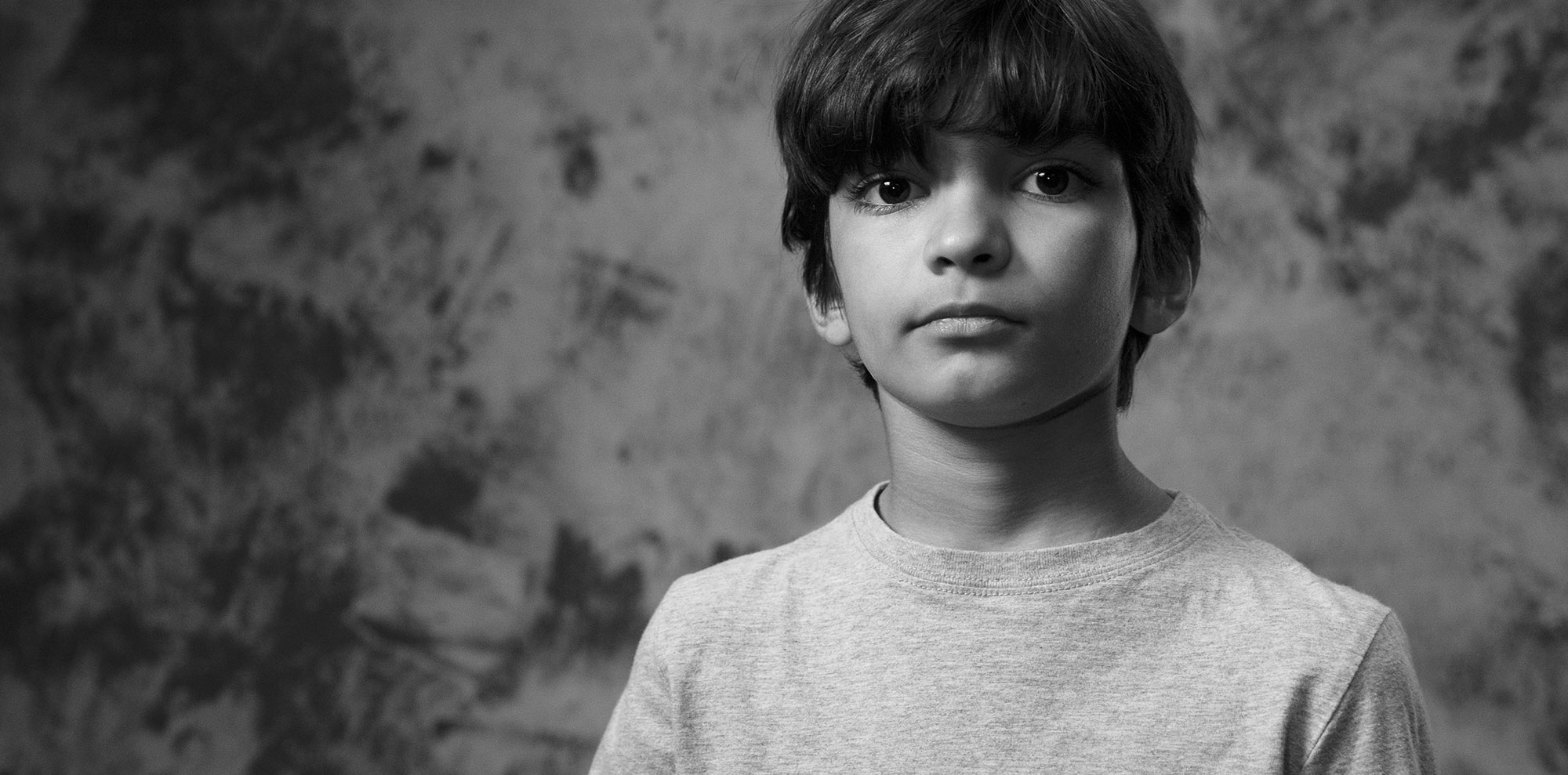 young boy with serious look